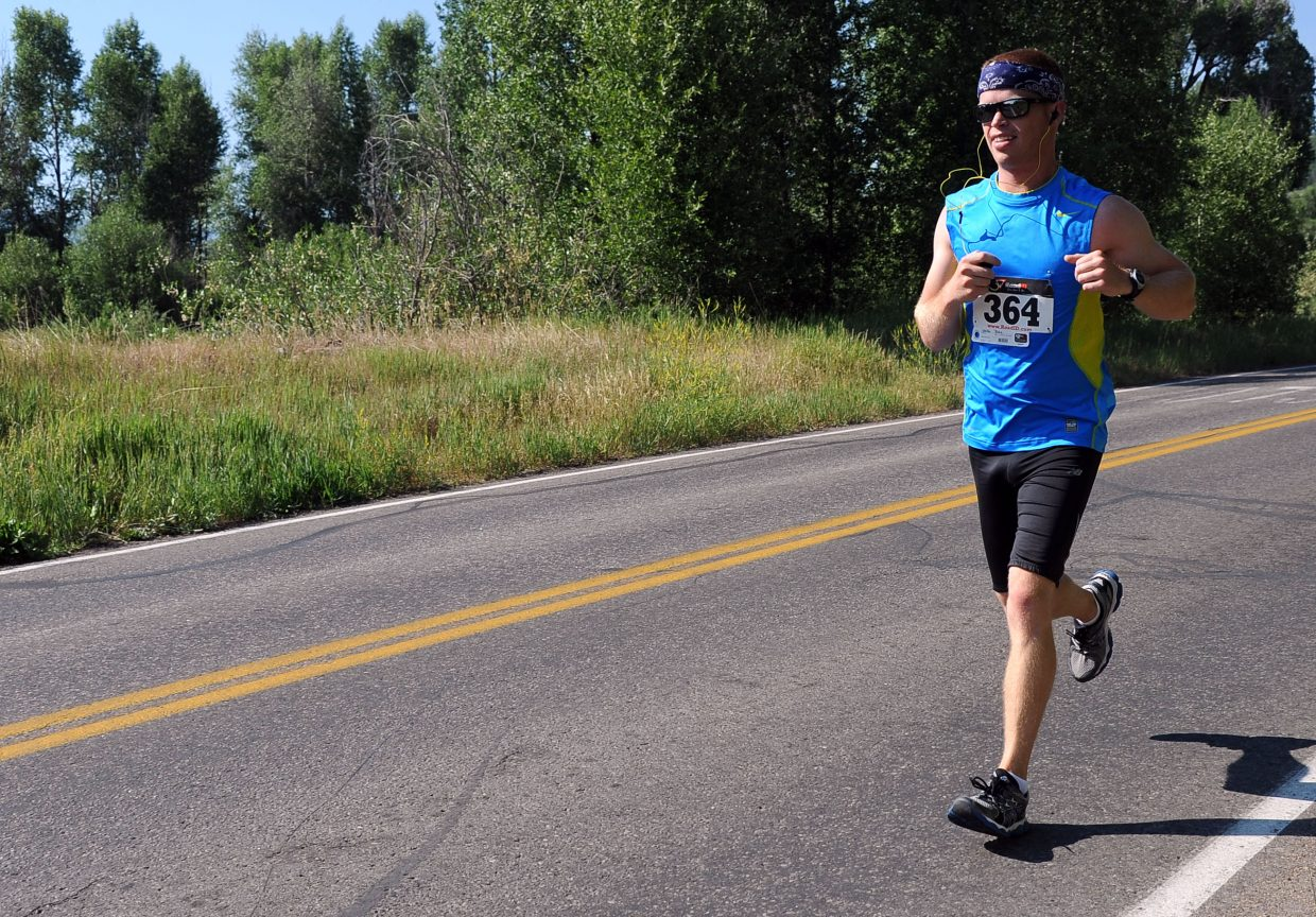 Jake Woller runs Sunday in the Mountain Madness half-marathon in Steamboat Springs.