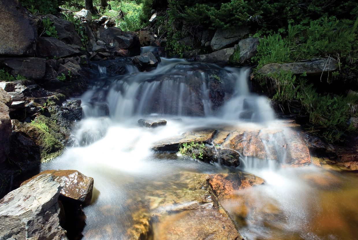 Water rolls over rocks in a small creek near the top of Buffalo Pass a few miles from Summit Lake Campground.