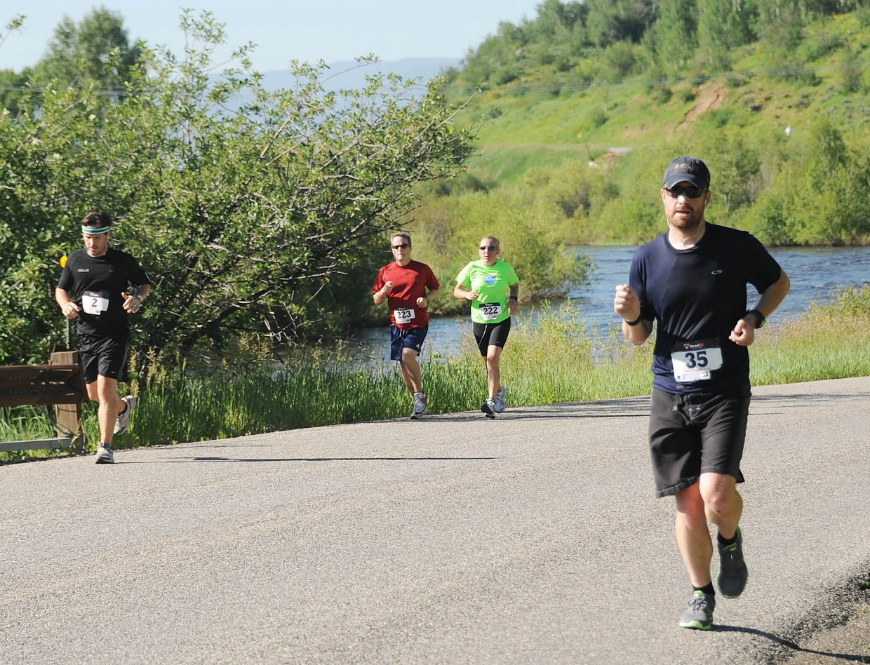 Matthew Hall, right, leads a pack of runners in the Mountain Madness race in Steamboat Springs.
