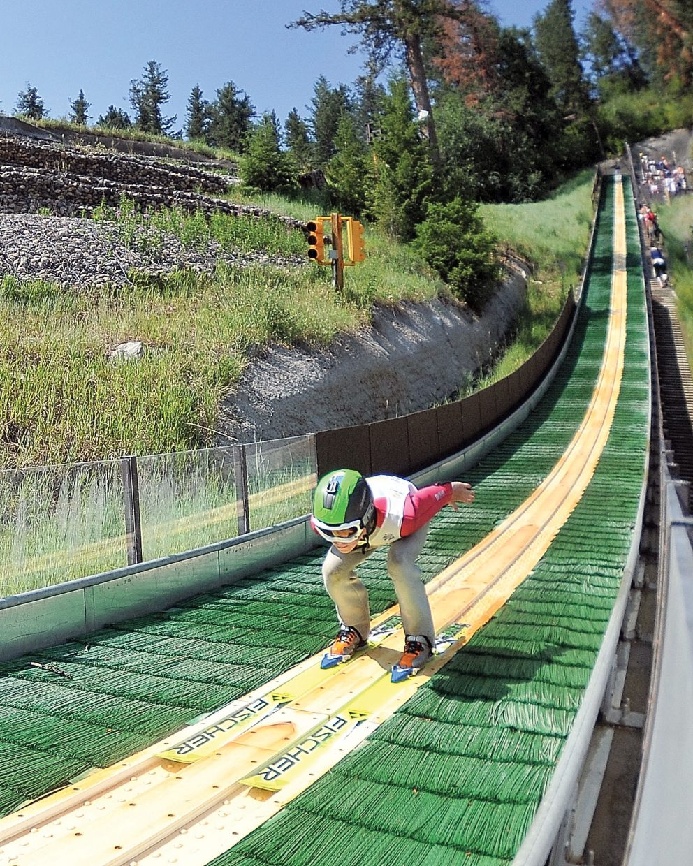 Finn O'Connell speeds down the in-run before taking flight Tuesday morning during the Fourth of July Ski Jumping Extravaganza at Howelsen Hill. Events will continue at 9:30 a.m. Wednesday with the Nordic combined roller-ski event on Lincoln Avenue and an elimination jump at 11 a.m. at Howelsen Hill.