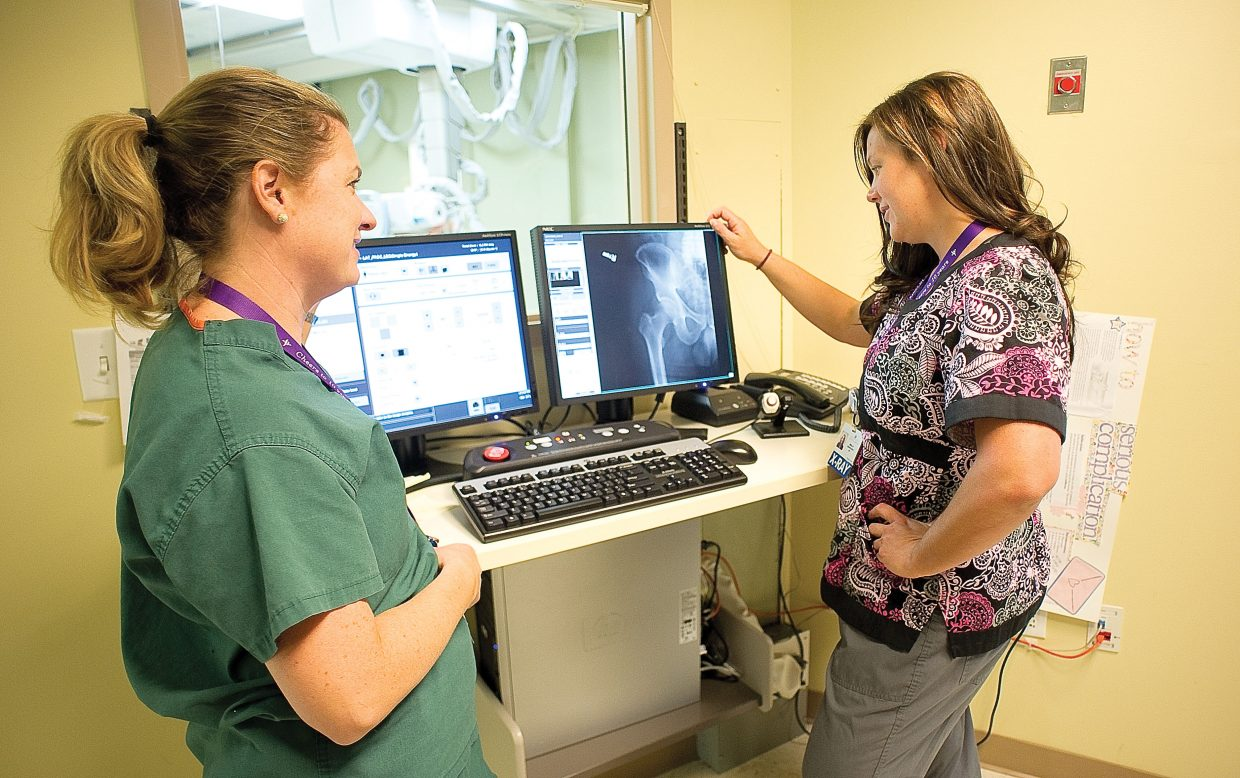 Registered Radiological Technologists Molly Nykamp, right, and Kathy Liberman, left, look over a digital X-ray in the Yampa Valley Medical Center's Diagnostic Imaging Department.