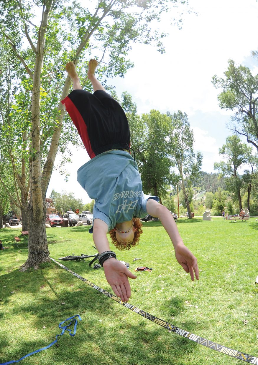 Parker Temple dismounts off a slackline in Little Toots Park on Friday afternoon.