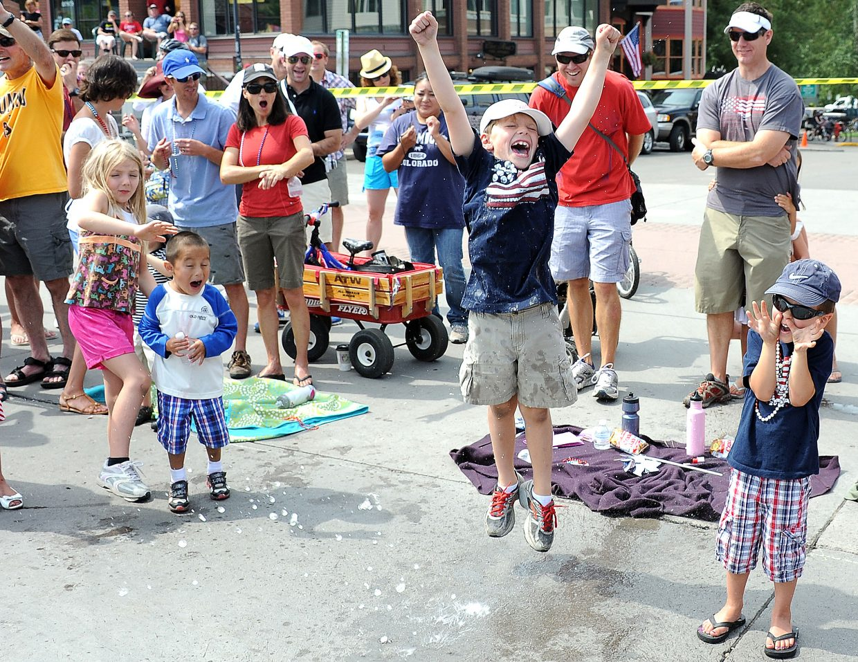 Tourists and locals alike packed the streets Wednesday morning for the Fourth of July parade through downtown Steamboat Springs. Hot weather and fire restrictions sapped some of the traditional activities out of the Fourth of July celebration, but it didn't take the enthusiasm from the crowd, which seemed to find particular joy in floats that sprayed water and offered relief from the heat.