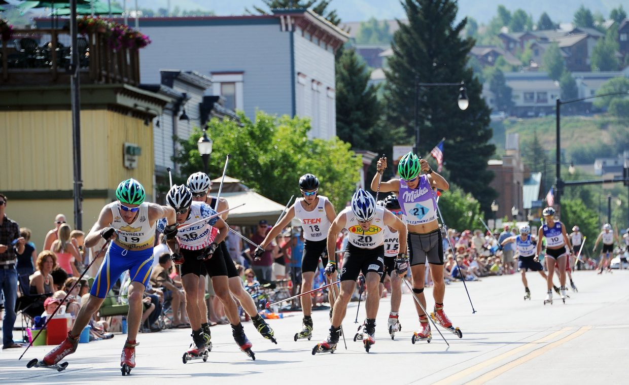 Adam Loomis, 19, leads a pack of skiers Wednesday in the downtown Steamboat Springs roller ski race.