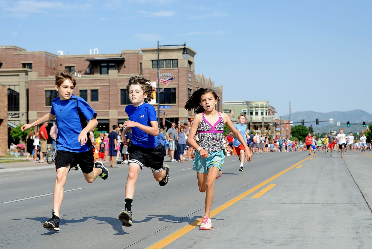 Maggi Congdon, 9, races in a deadheat with a pair of boys during the Steamboat Sprint, a 400-yard dash down Lincoln Avenue before the Fourth of July Parade in Steamboat Springs.