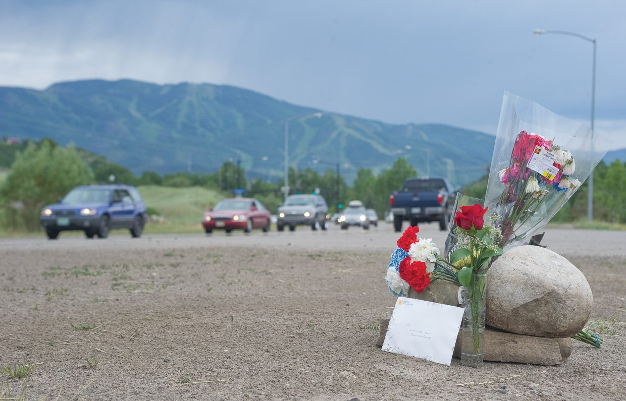 A small memorial was set up Wednesday just west of the Steamboat Springs Community Center on Lincoln Avenue, where a 60-year-old German man was killed Tuesday after a Jeep Liberty drove into his lane and hit his motorcycle head-on. The man was identified Wednesday as Fels Bernhard. The driver of the Jeep Liberty told police he was suffering from a medical condition, which caused him to drift into oncoming traffic. Bernhard was visiting the United States with four friends on a motorcycle tour. Routt County Coroner Rob Ryg said Bernhard worked at a bank in Germany.
