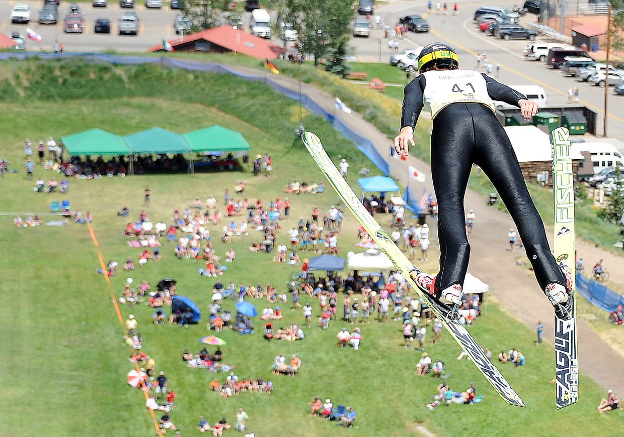 Kevin Bickner jumps above a large crowd Thursday in Steamboat Springs.