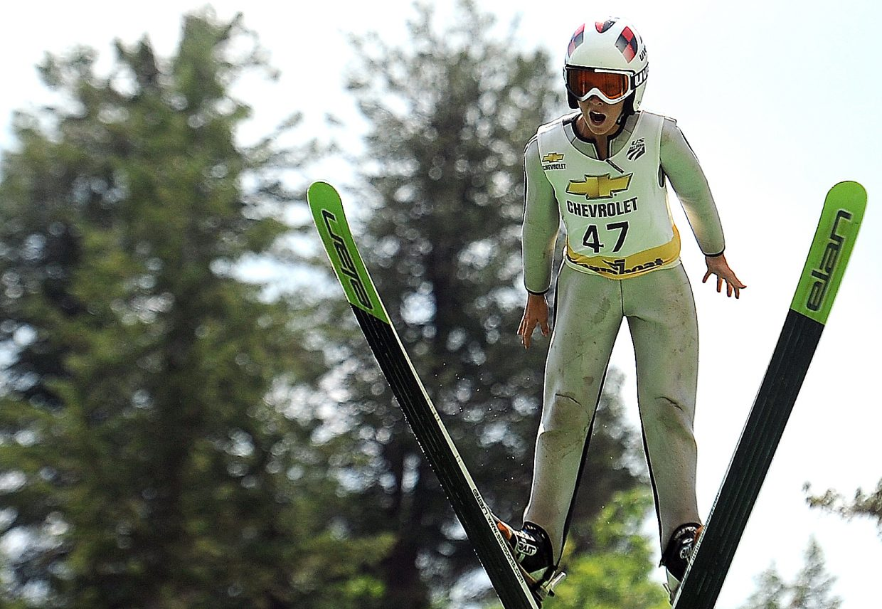 Decker Dean flies off the jumps in Steamboat Springs on Thursday. Dean, 12, finished second in the day's jumping competition.