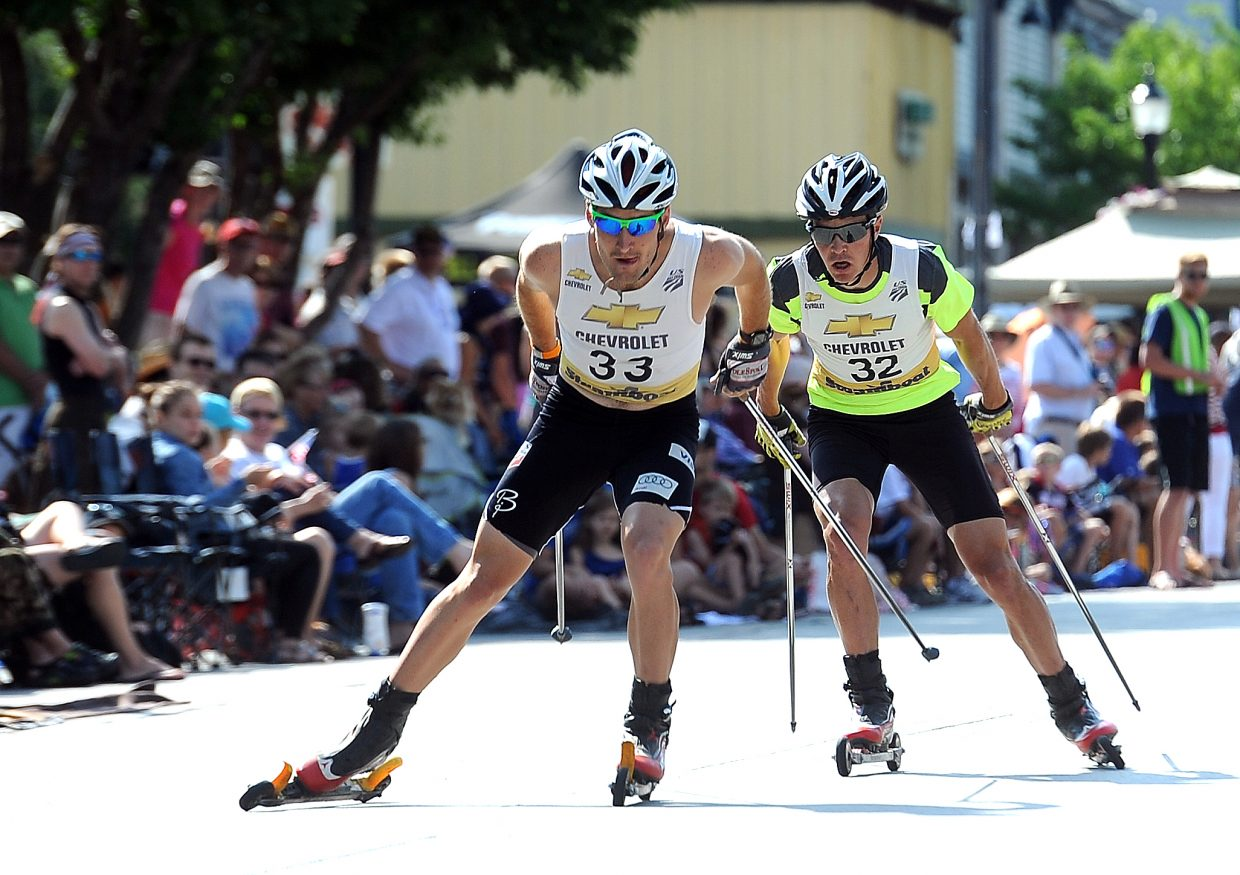 Taylor Fletcher leads Billy Demong midway through the Ski Jumping Extravaganza roller-ski event in downtown Steamboat Springs on Thursday. Demong pulled ahead later to finish second, behind Todd Lodwick, while Fletcher was third.