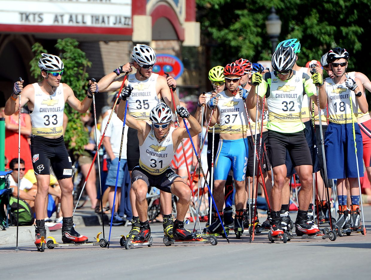 Todd Lodwick crouches as he waits for the start of the roller-ski race in downtown Steamboat Springs.