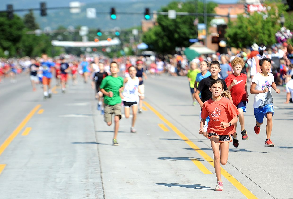Runners rush toward the finish line of Saturday's Steamboat Sprint event in downtown Steamboat Springs.