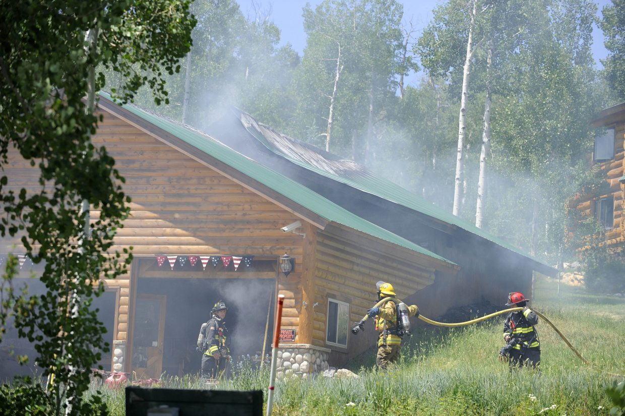 Firefighters work at a fire Wednesday morning on Jupiter Place in North Routt County.