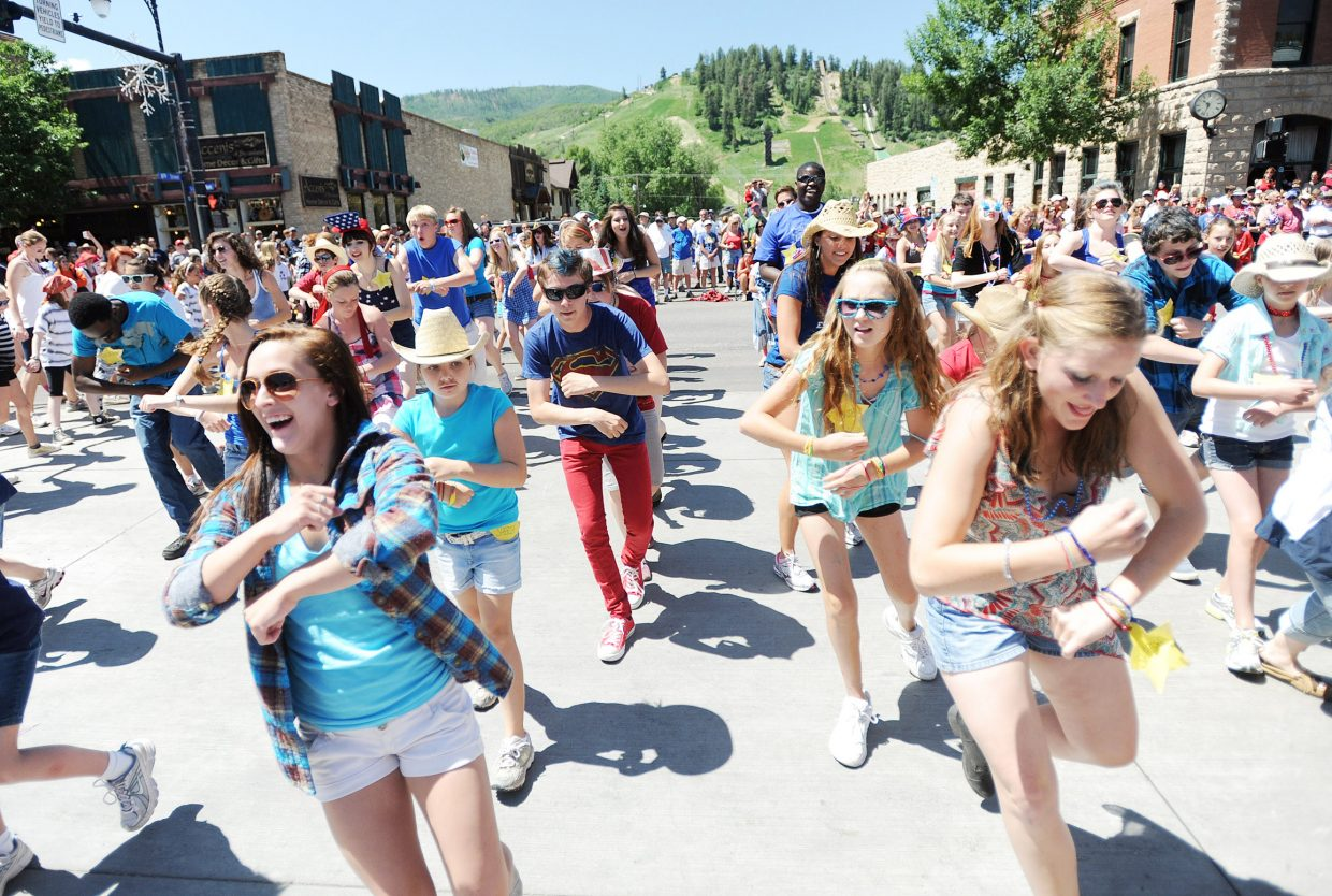 The Perry-Mansfield Performing Arts School and Camp performers put on their routine on Lincoln Avenue in downtown Steamboat Springs on Sunday during the Fourth of July parade.