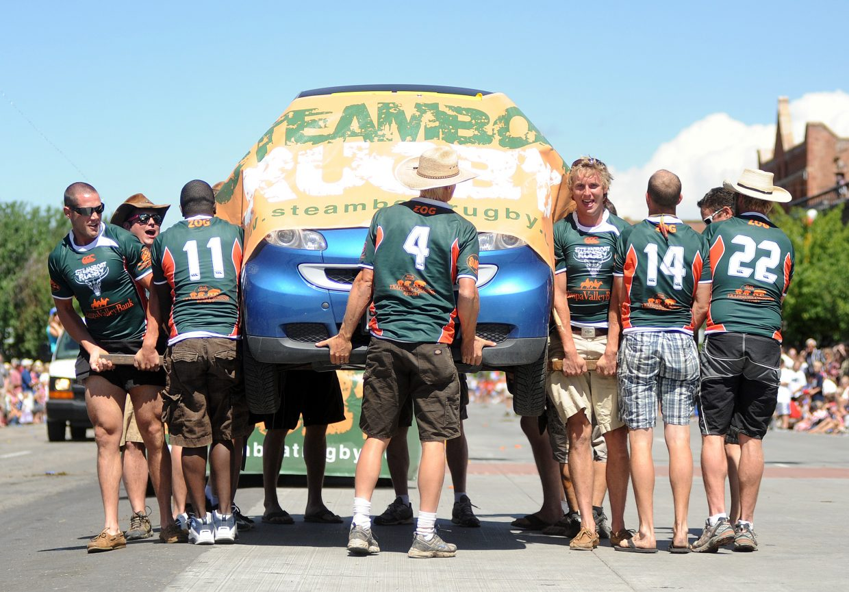 The Steamboat Rugby Club puts its muscles on display Sunday during the Fourth of July parade in Steamboat Springs.