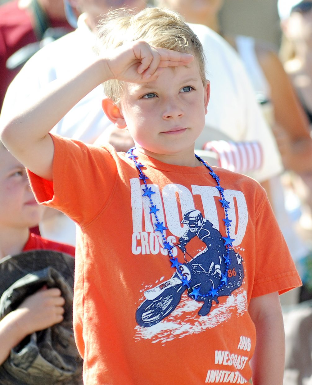 Ryder Pride, 7, salutes during the national anthem before the start of Sunday's July 4 parade in downtown Steamboat Springs.