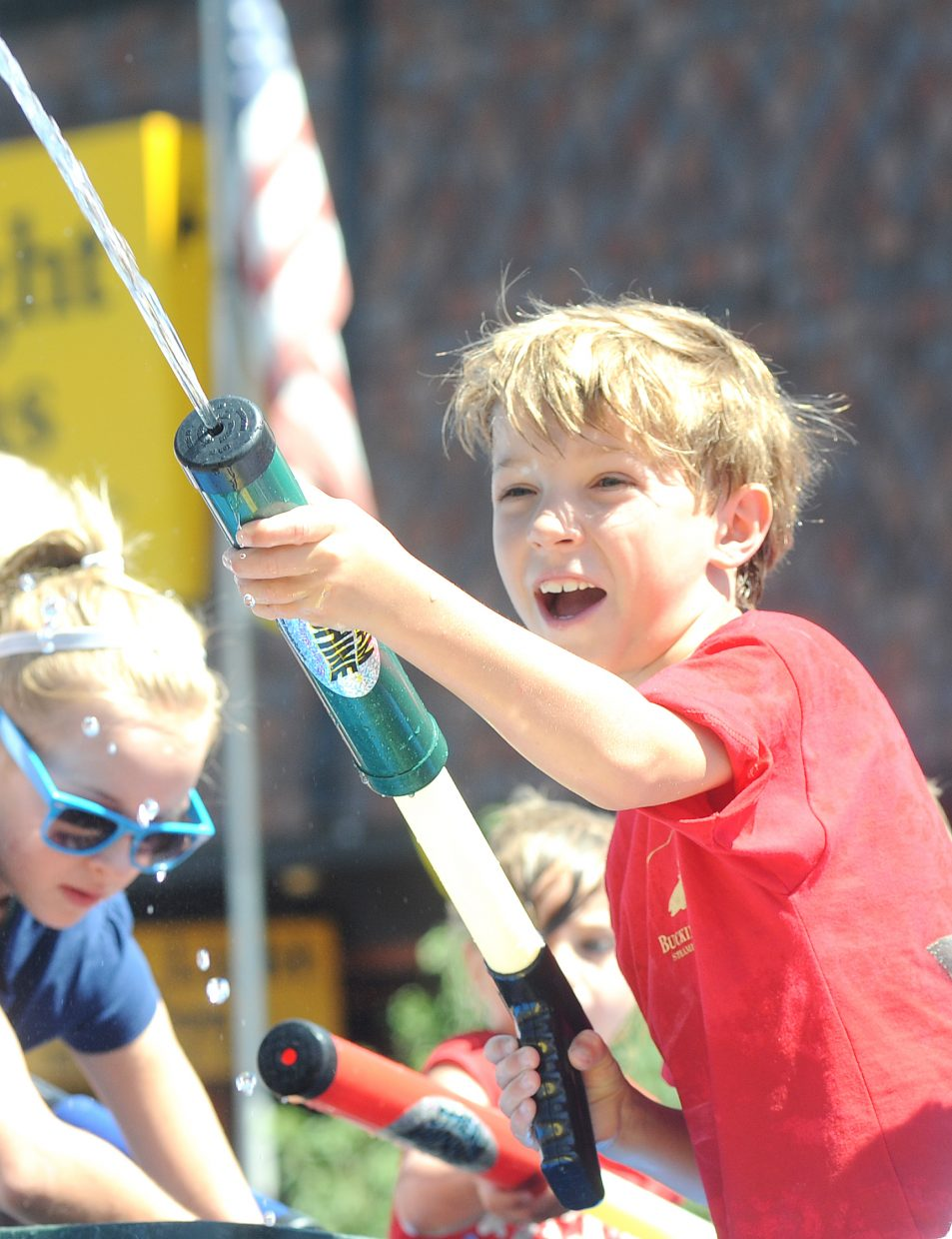 Alan Duty, 7, sprays the crowd on Sunday during the Fourth of July parade in downtown Steamboat Springs.