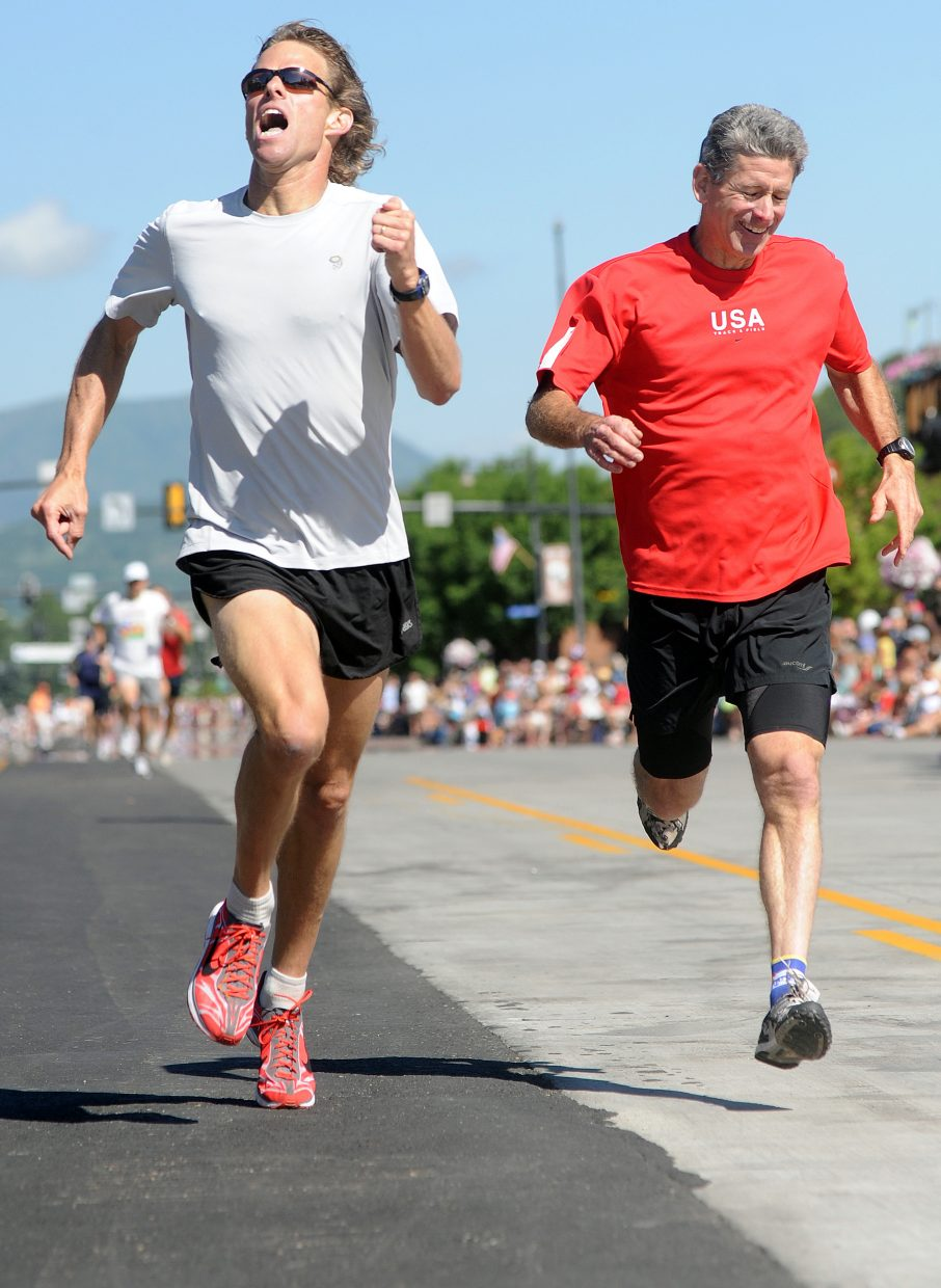Craig Heacock, left, of Fort Collins, and Steamboat's Greg Long dive for the finish line in Sunday's Steamboat Springs, a 400-yard dash down Lincoln Avenue that took place right before the start of the July 4 parade. Heacock won, edging out the hometown runner.