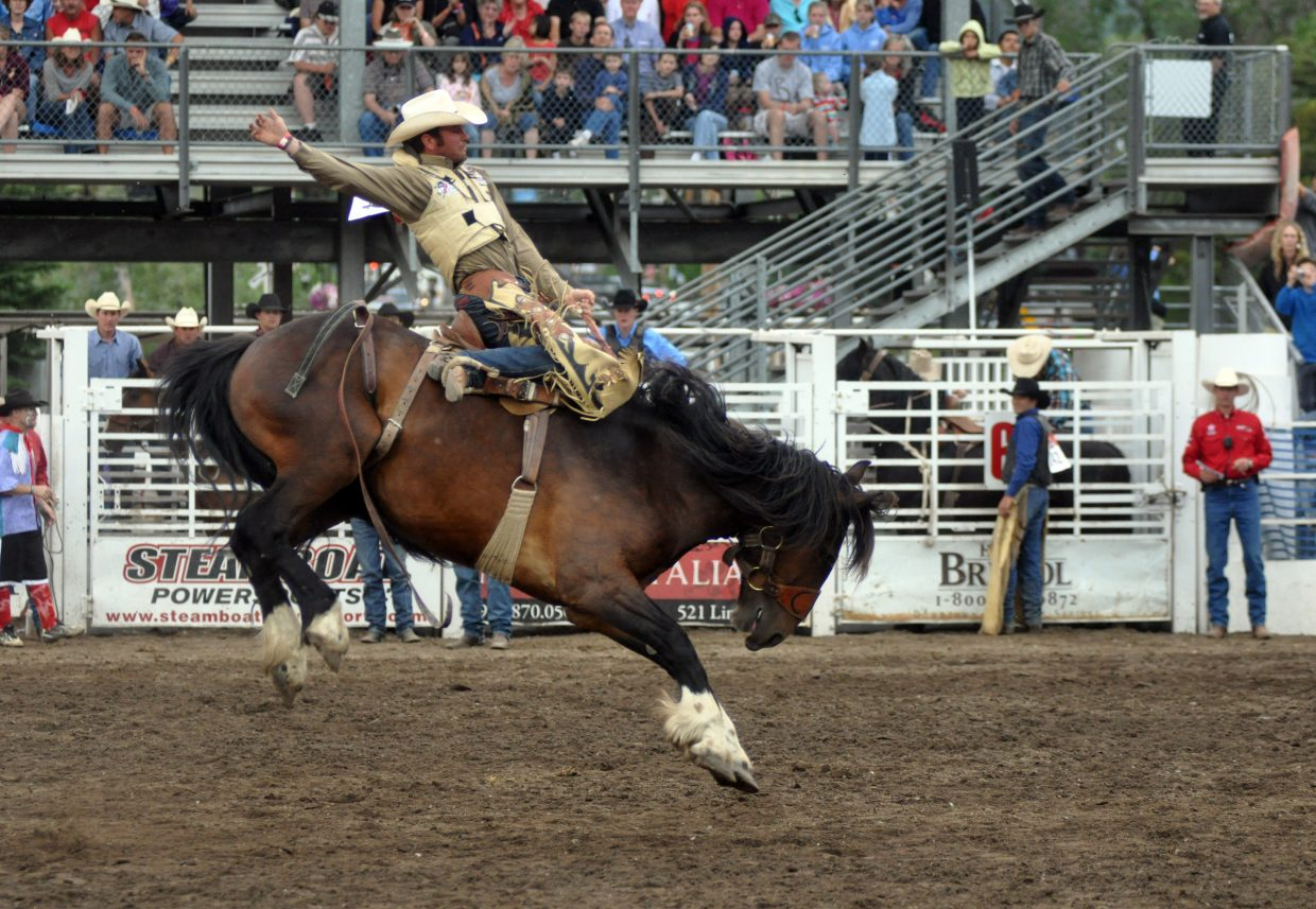 Wade Mosher hangs on during the saddle bronc riding competition at the 2011 Steamboat Springs Pro Rodeo Series. The Fourth of July rodeo event this year starts at 6:30 p.m.