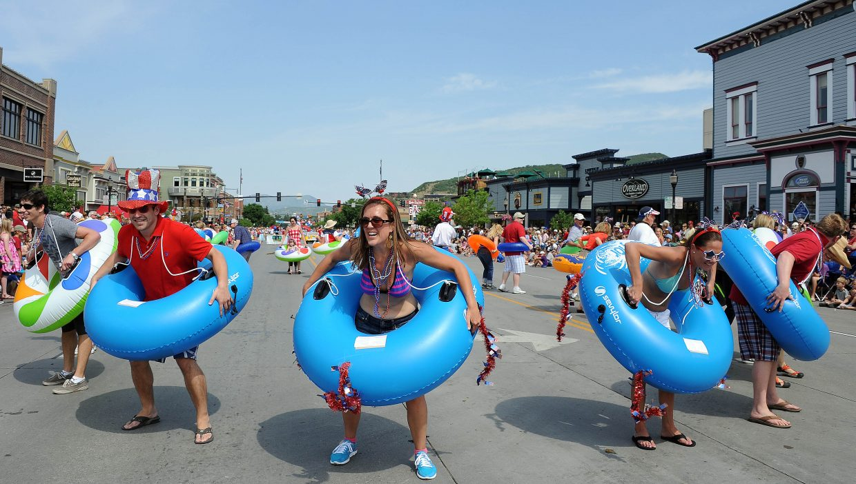 Dancers run through their routine Wednesday during the Fourth of July parade in downtown Steamboat Springs.