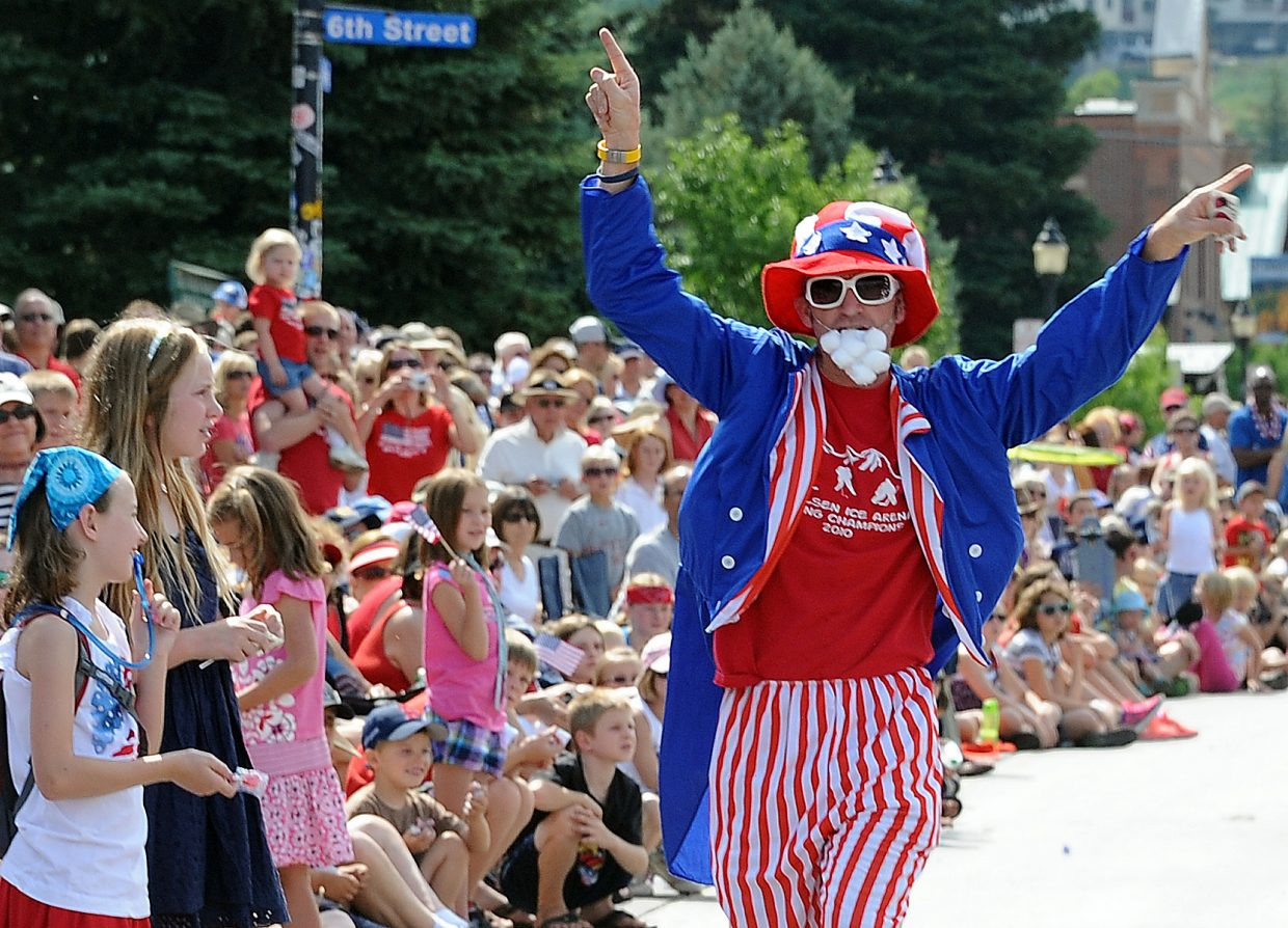 Uncle Sam PJ Wharton riles up the crowd Wednesday during the Fourth of July parade in Steamboat Springs.