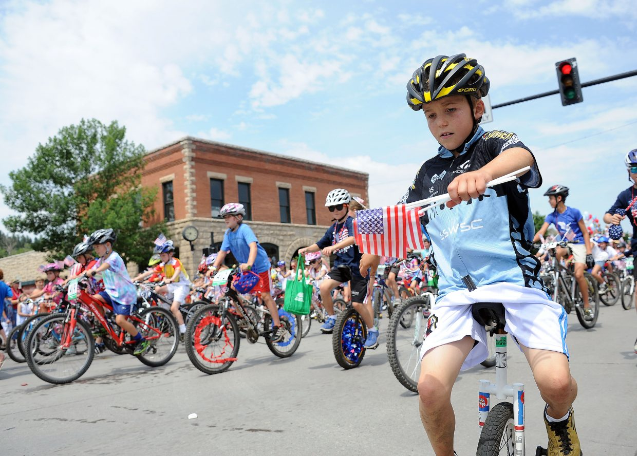 Bennett Gamber rides a unicycle at the front of the Steamboat Springs Winter Sports Club segment of the Fourth of July parade in Steamboat Springs.