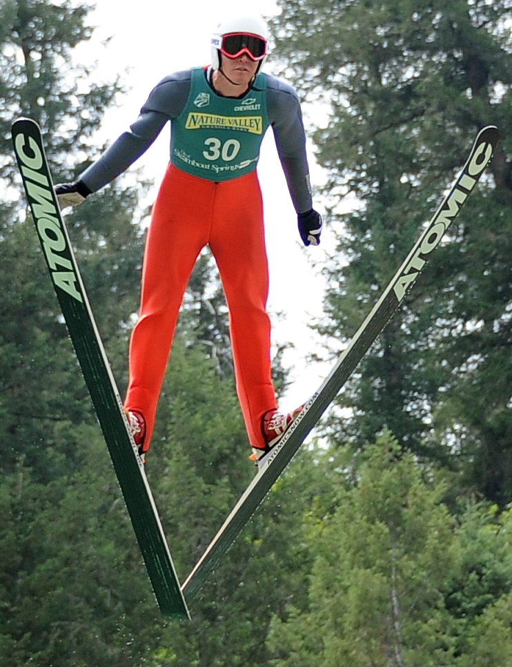 Olympic gold medalist Billy Demong jumps Wednesday during Fourth of July festivities in Steamboat Springs.