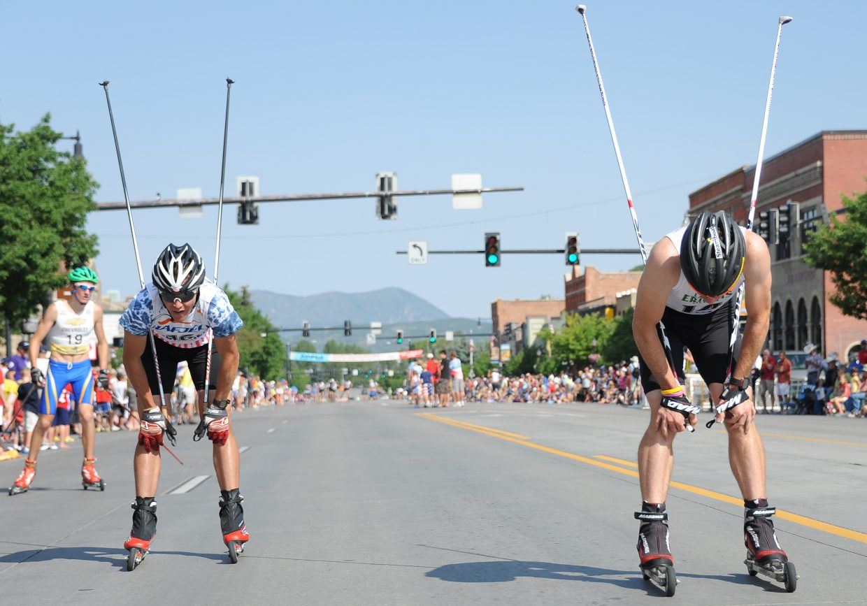 U.S. Nordic combined Ski Team athletes Billy Demong, left, and Bryan Fletcher try to catch their breath after the roller ski race on Lincoln Avenue on Wednesday in Steamboat Springs.