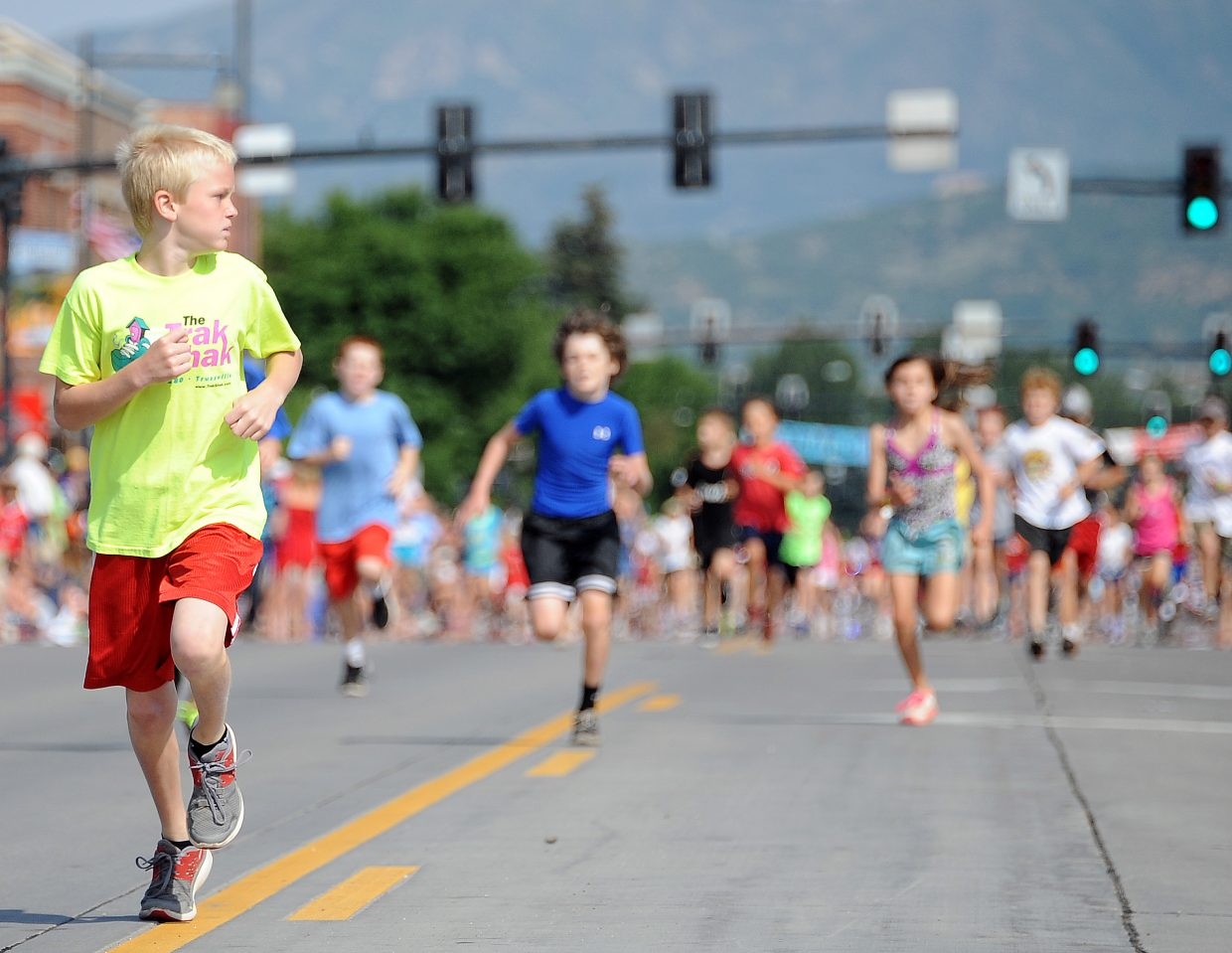 Ethan Strand, 9, of Birmingham, Ala., looks to see if anyone is close to him as he nears the end of the 400-yard Steamboat Springs on Lincoln Avenue in downtown Steamboat Springs. He was in a class by himself, easily winning the boys 10 and under division of the race.