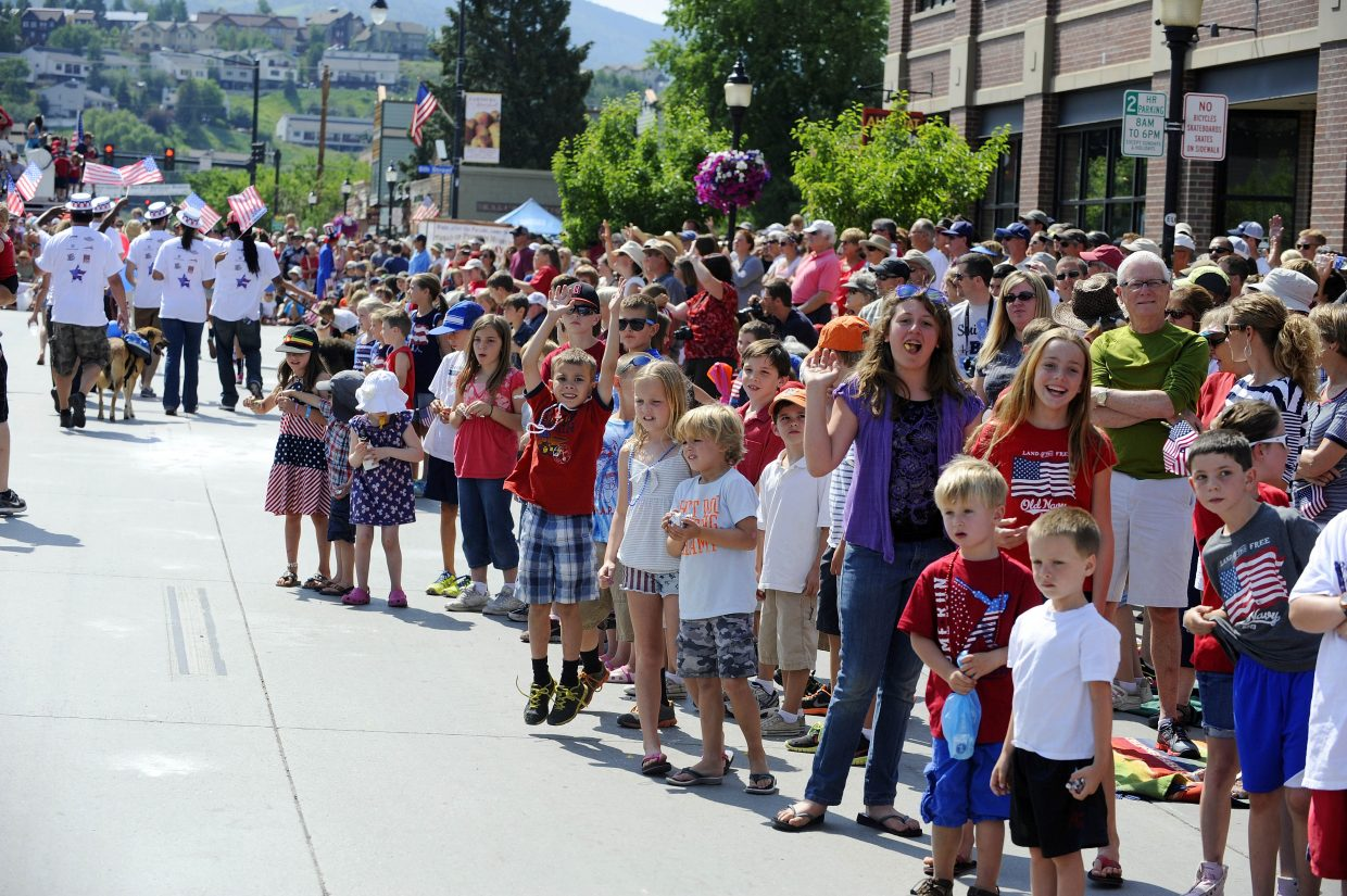 Spectators line Lincoln Avenue during the July 4 parade.