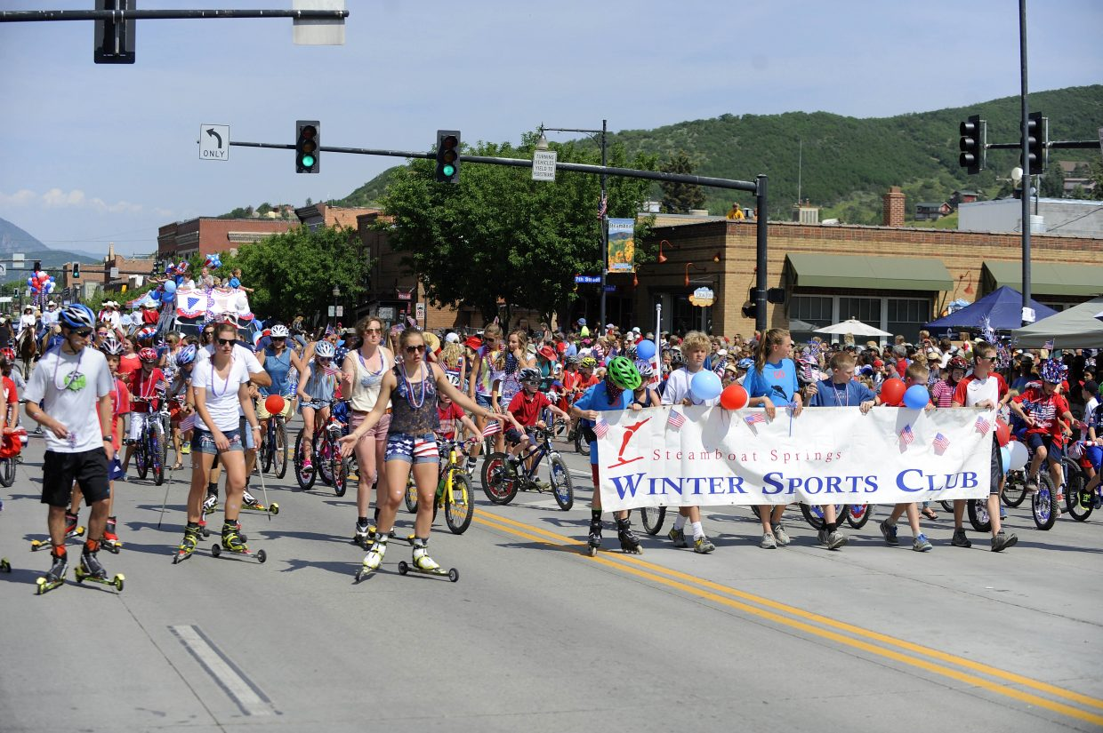 Steamboat Springs Winter Sports Club members march in the July 4 parade on Lincoln Avenue.