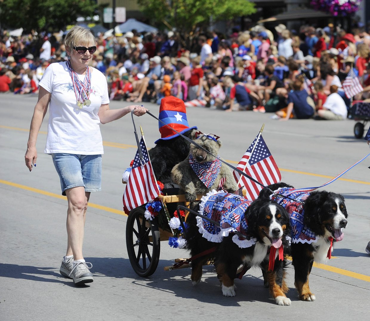 Steamboat Springs resident Barbara Clark walks her dogs Vernors, right, and Julia during the July 4 parade on Lincoln Avenue. She was walking with the Heeling Friends group.