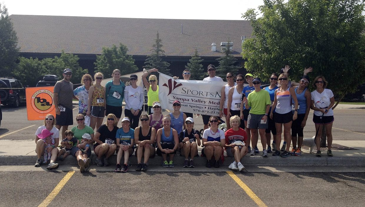 Employees from SportsMed at Yampa Valley Medical Center help put on Saturday's Mountain Madness race in Steamboat Springs.
