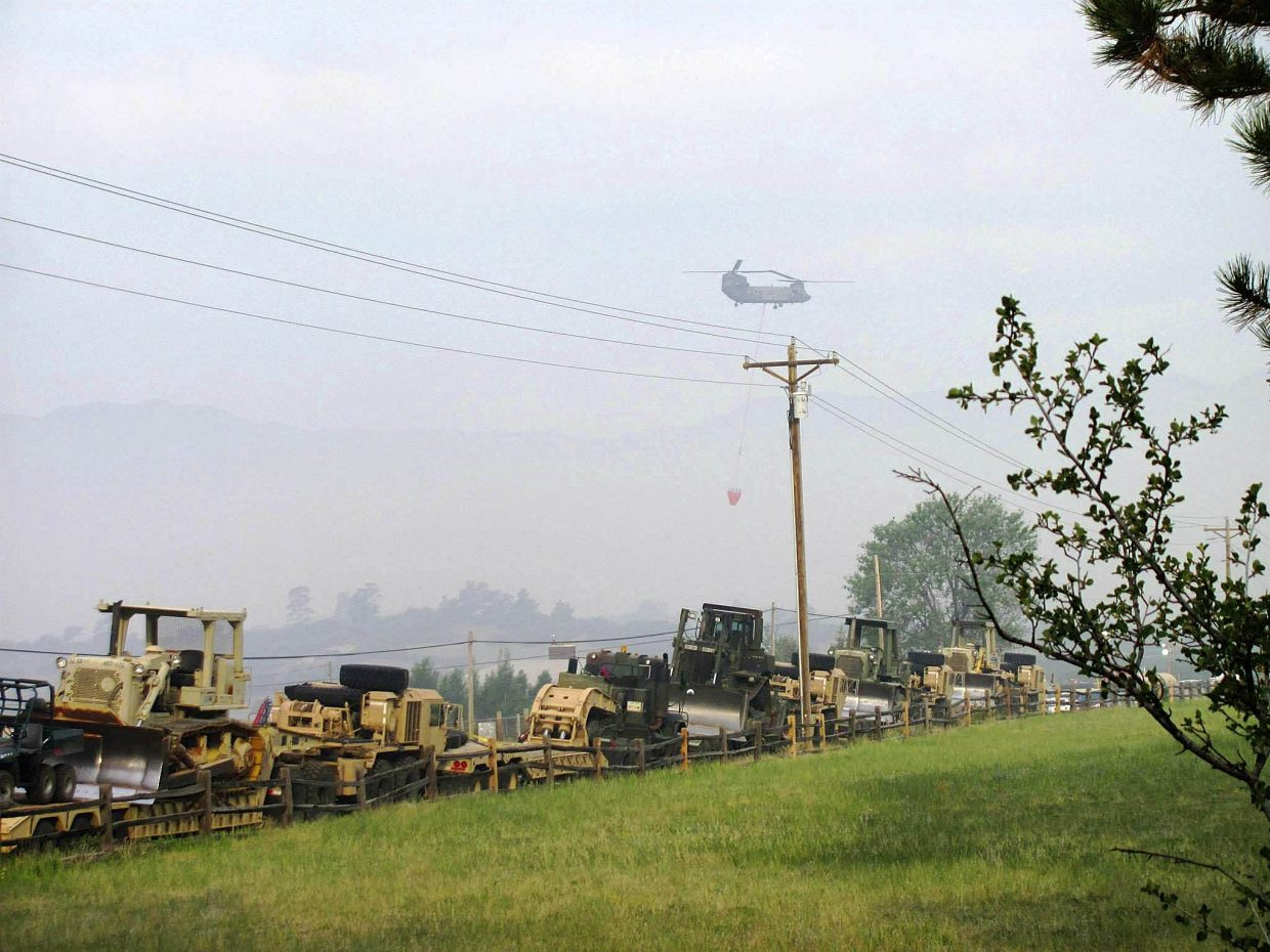 Bulldozers are staged along a road at the Black Forest Fire.