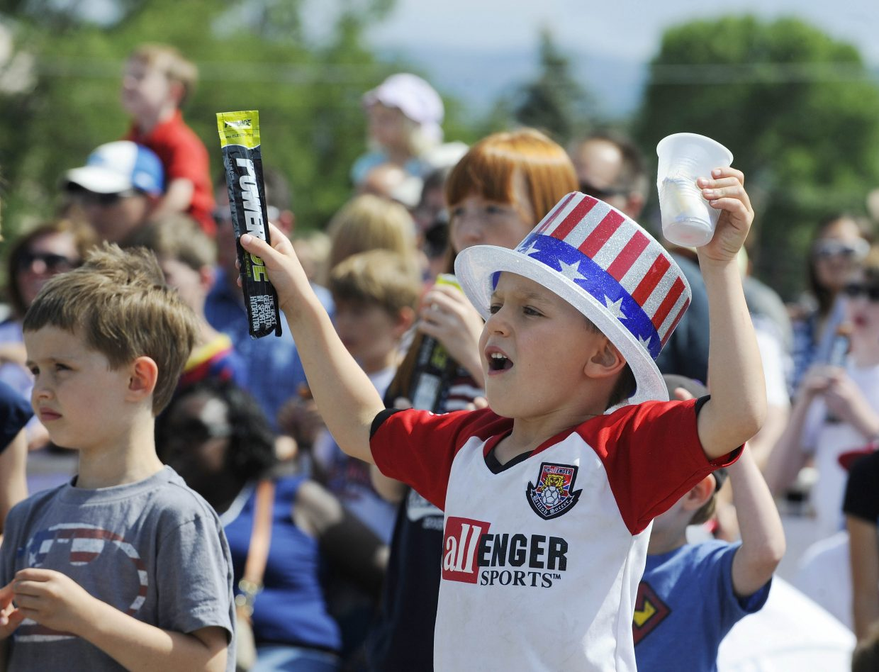 Ben Sherr, of Highlands Ranch, holds a PowerICE passed out during the July Fourth parade in downtown Steamboat Springs.