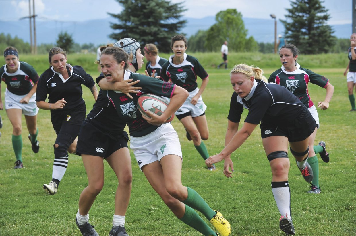 Katie Furnivall tries to break a tackle Saturday at the 38th annual Cow Pie Classic rugby tournament. The Steamboat Women's Rugby team made its debut Saturday, finishing 1-2.
