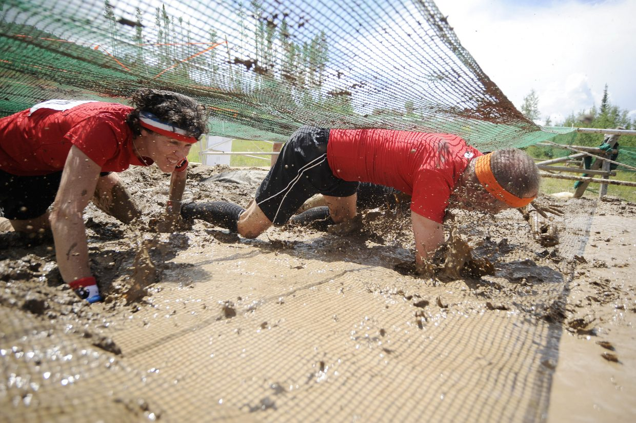 Kathy Elliott crawls through the mud pit during the 2012 Steamboat Mad Mud Run at Steamboat Ski Area.