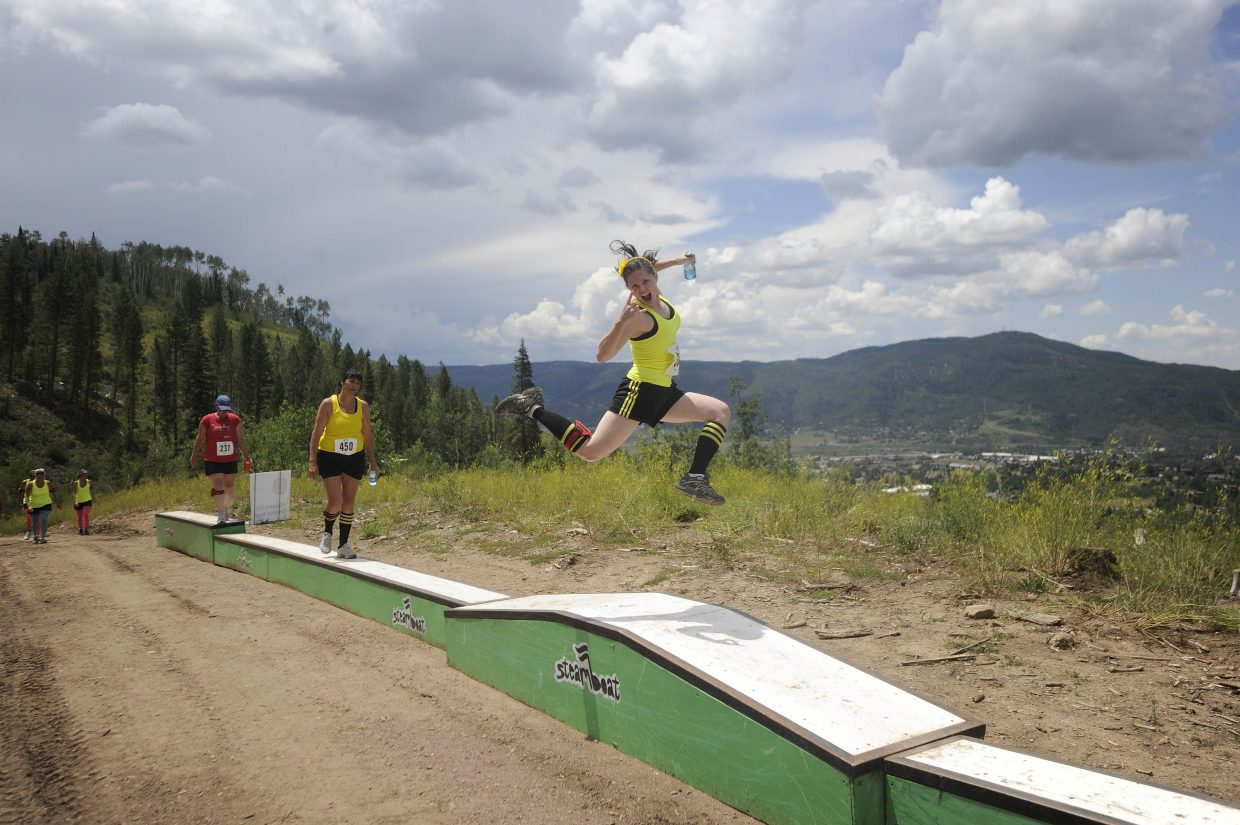 A participant jumps in the air while competing in the Steamboat Mad Mud Run on Saturday at Steamboat Ski Area.