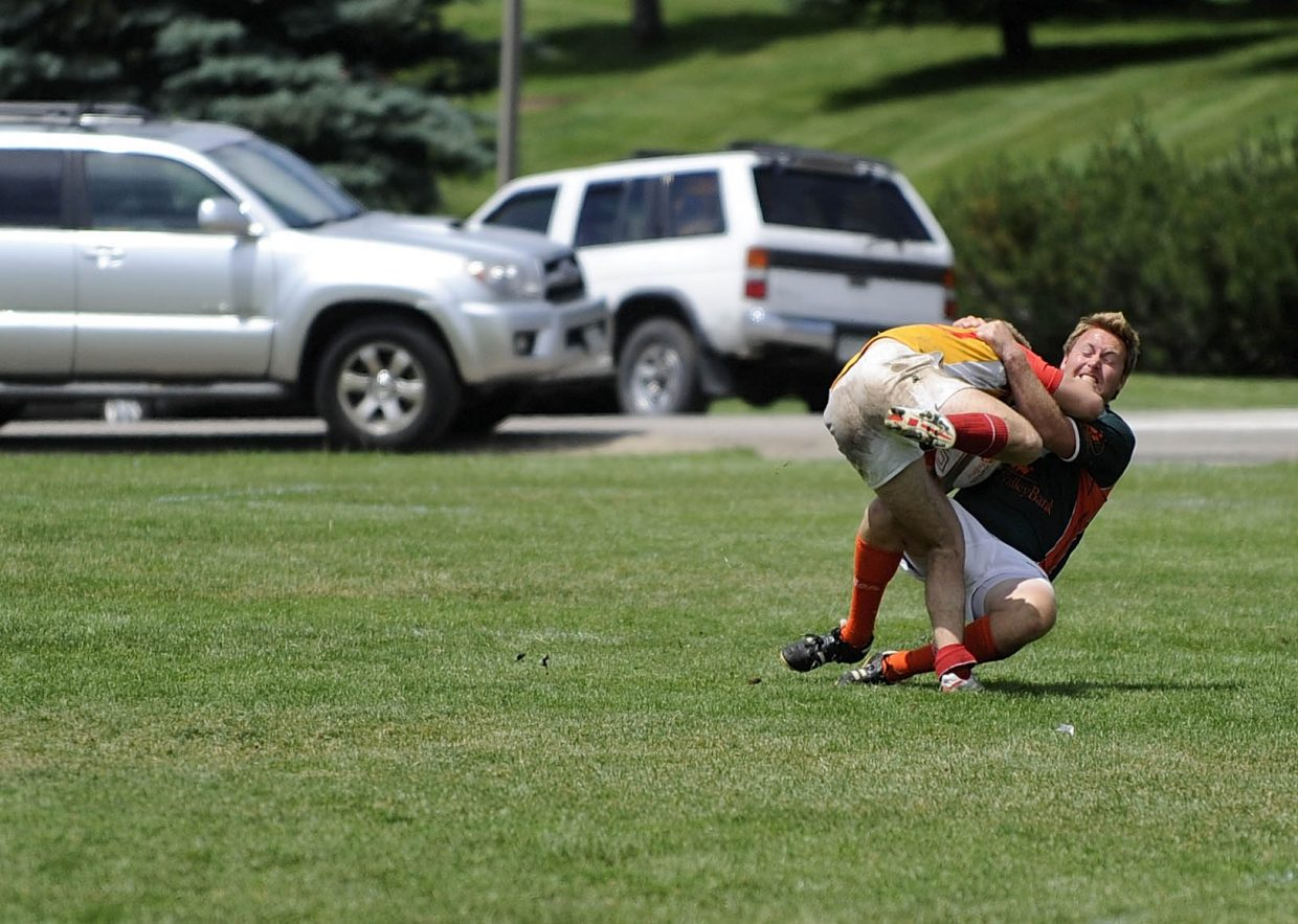 Steamboat Springs rugby player Michael Hurley tosses the ball during Saturday's 2011 Cow Pie Classic Rugby Tournament.