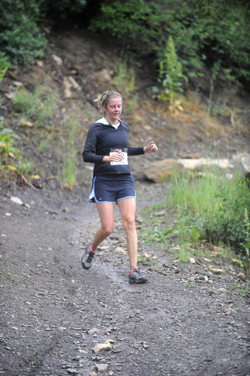 Steamboat Springs resident Sahra Beaupre runs down the trail during Saturday's four-mile race at the Howelsen Hill 8-miler.