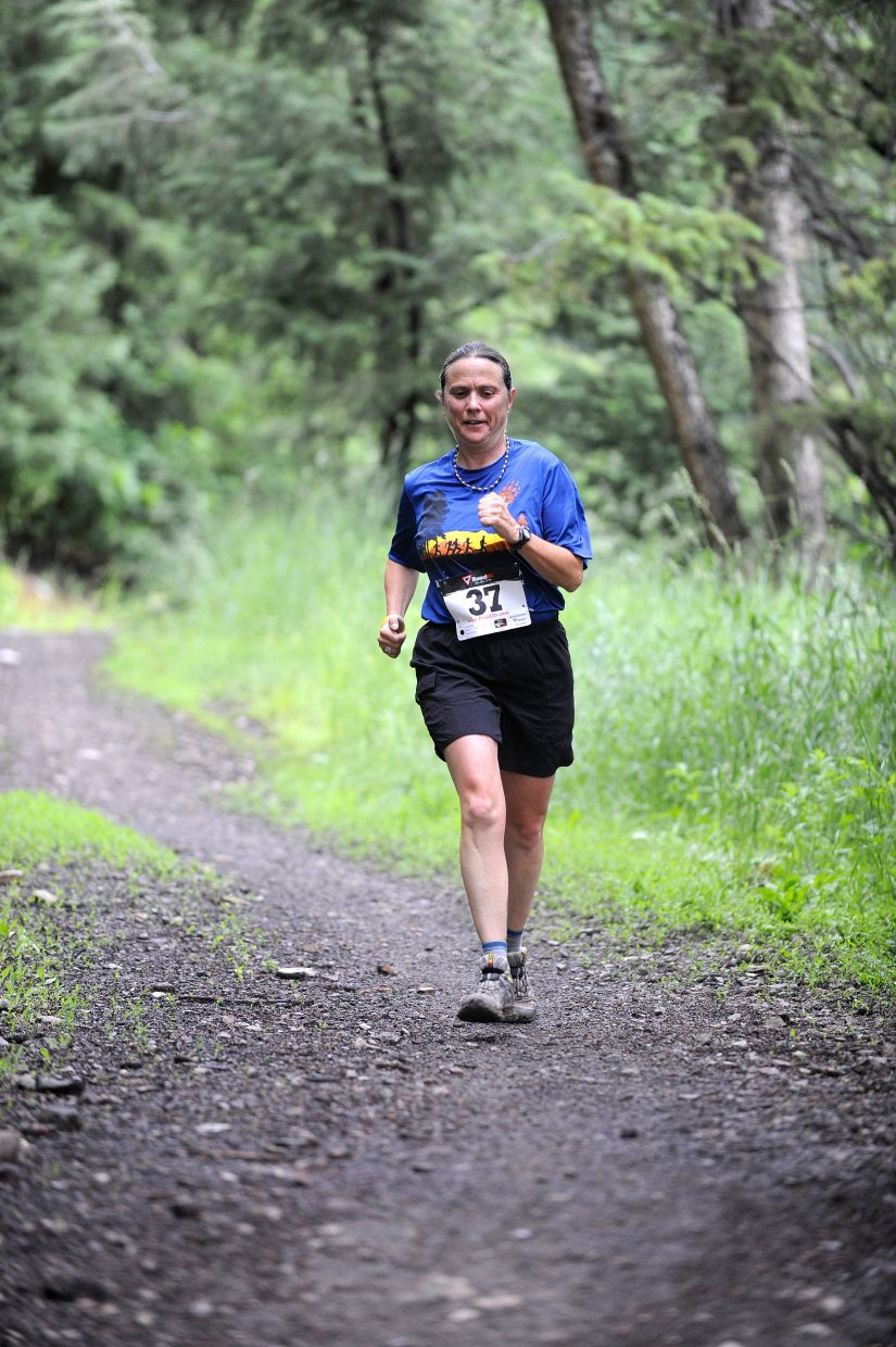 Meg Halford, of Boulder, runs down the trail during Saturday's four-mile race at the Howelsen Hill 8-miler.