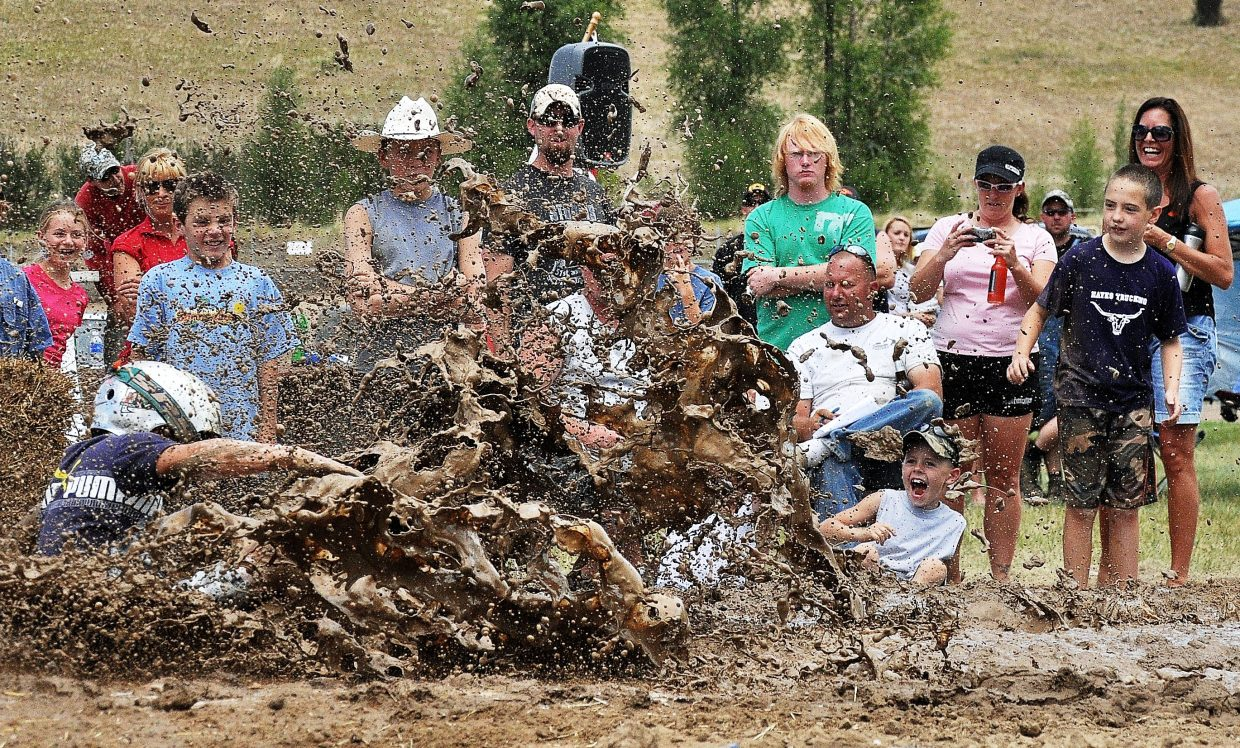 Isaac Phillips splashes into a mud pit during the first Routt County Redneck Olympics in Hayden. The second installment of the games starts this weekend.