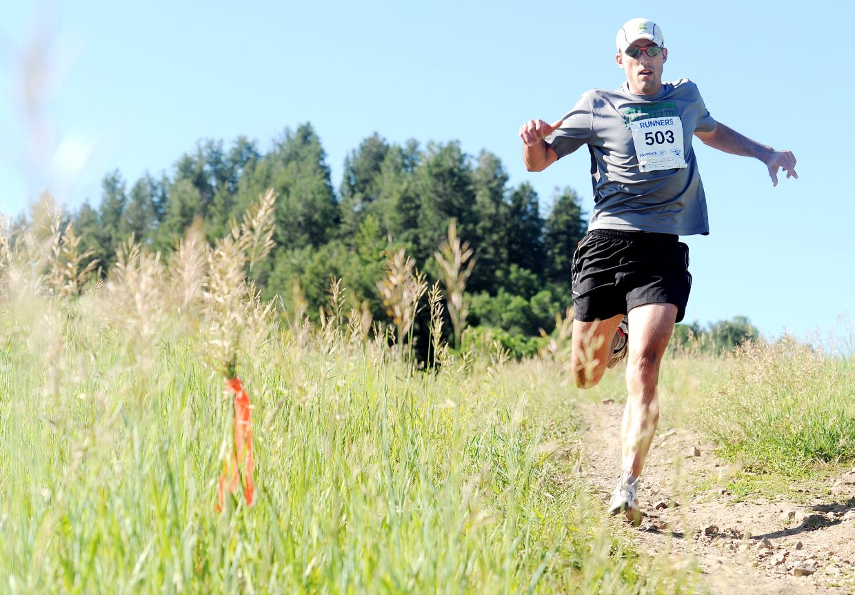 Eric Bergman flies down after one of the final climbs in Saturday's Howelsen Hill 8-miler. Bergman, a Fort Collins runner, won the race in 56 minutes, 16 seconds.