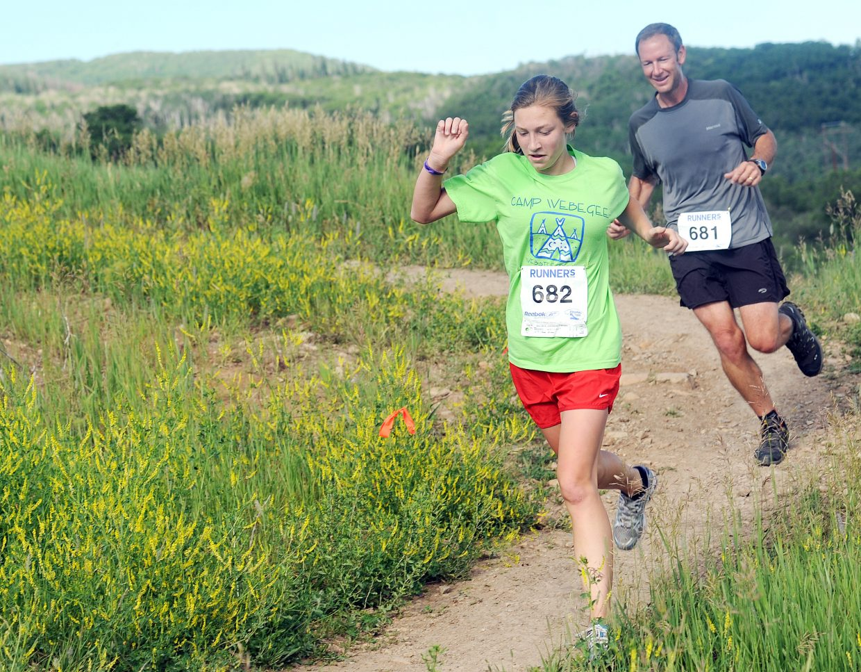 Bridget Boeger and Michael Boeger navagite a rocky section of the Howelsen Hill trail used Saturday for a 4-mile race.