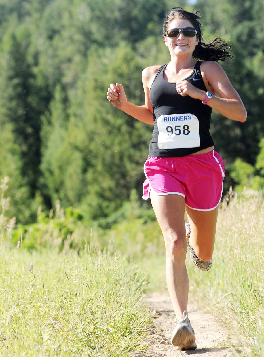 It's all downhill for Howelsen Hill 8-Miler competitor Amanda Spina on Saturday as she heads toward the finish line of the downtown Steamboat Springs race. She finished second in the 8-mile women's division.