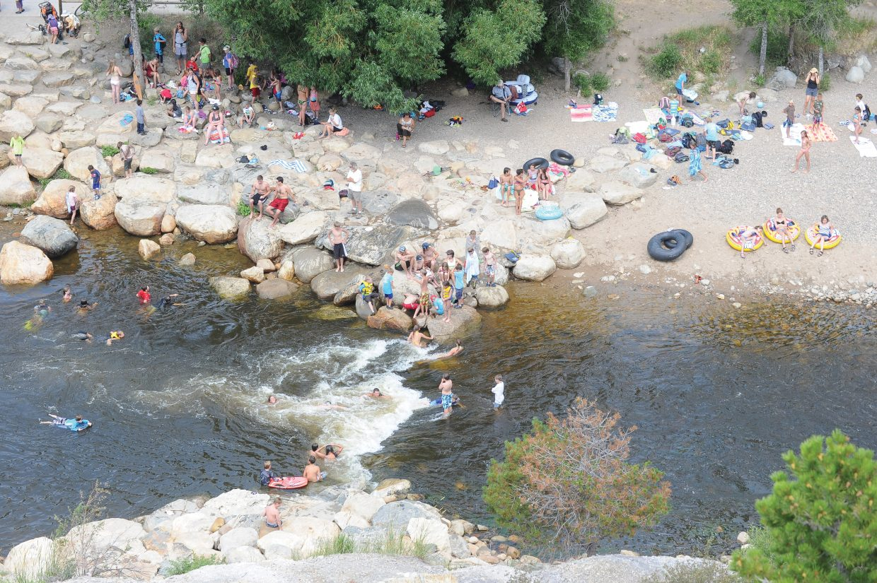 Swimmers gather around Charlie's Hole in Steamboat Springs on Thursday afternoon in an effort to beat the heat.