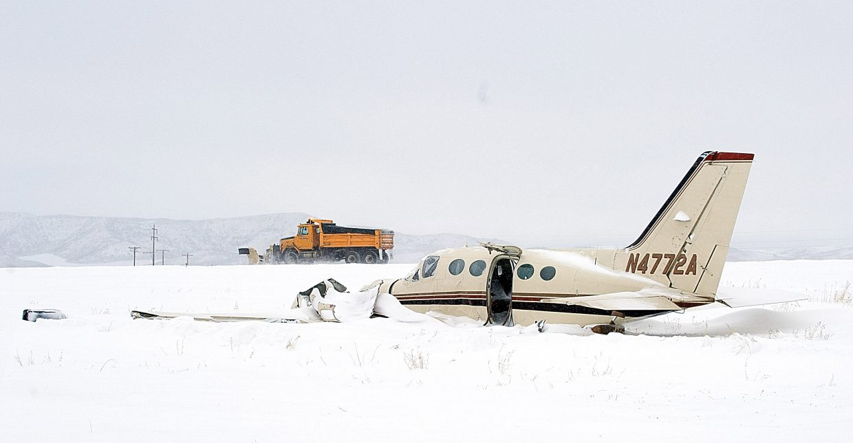 A snowplow clears the runway Feb. 20, 2012 at Yampa Valley Regional Airport, where a private plane from Texas crashed in a snowstorm. The National Transportation Safety Board determined adverse weather and icing on the plane likely contributed to the deadly crash.