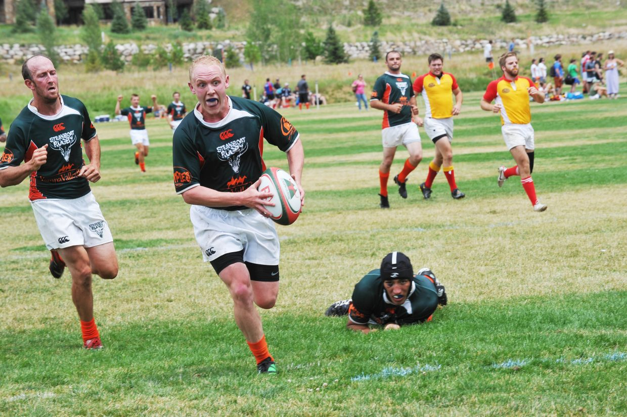 Tucker Brock scores a try during the 38th annual Cow Pie Classic rugby tournament in 2012. Steamboat won the tournament for the fifth time in six years, beating Wyoming, 13-8. This year's tournament is Saturday.