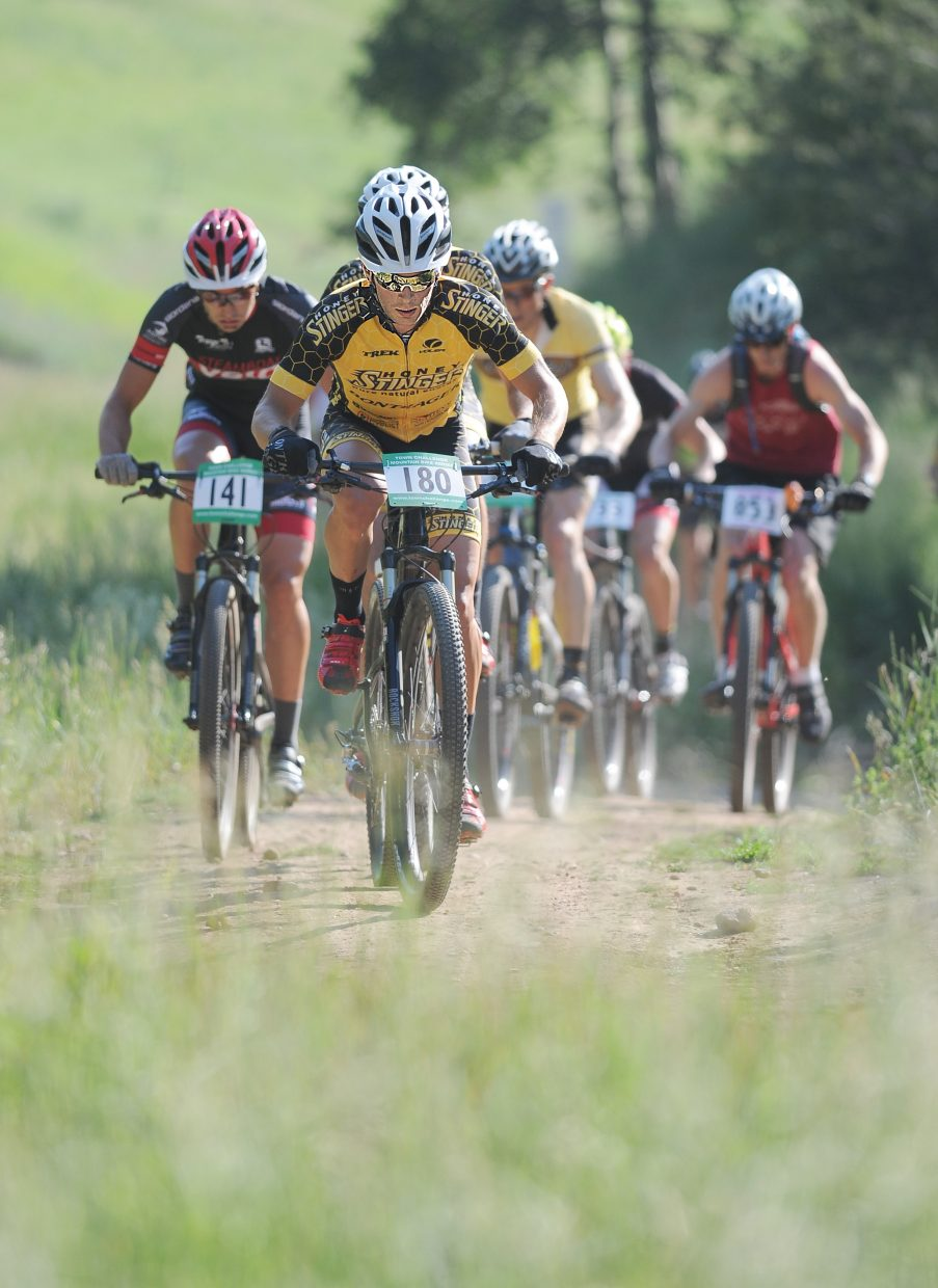 Mountain bike racer Trevor Walz leads a pack of riders up Zig Zag during Wednesday night's Sunshine Loop race at Steamboat Ski Area.