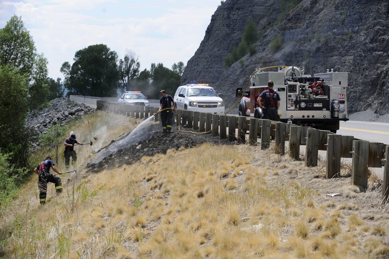 Steamboat Springs Fire Rescue firefighters put out a fire Thursday afternoon along U.S. Highway 40 on the west edge of Steamboat. It was not immediately clear what caused the fire, but similar fires have been caused by cigarettes thrown from cars.