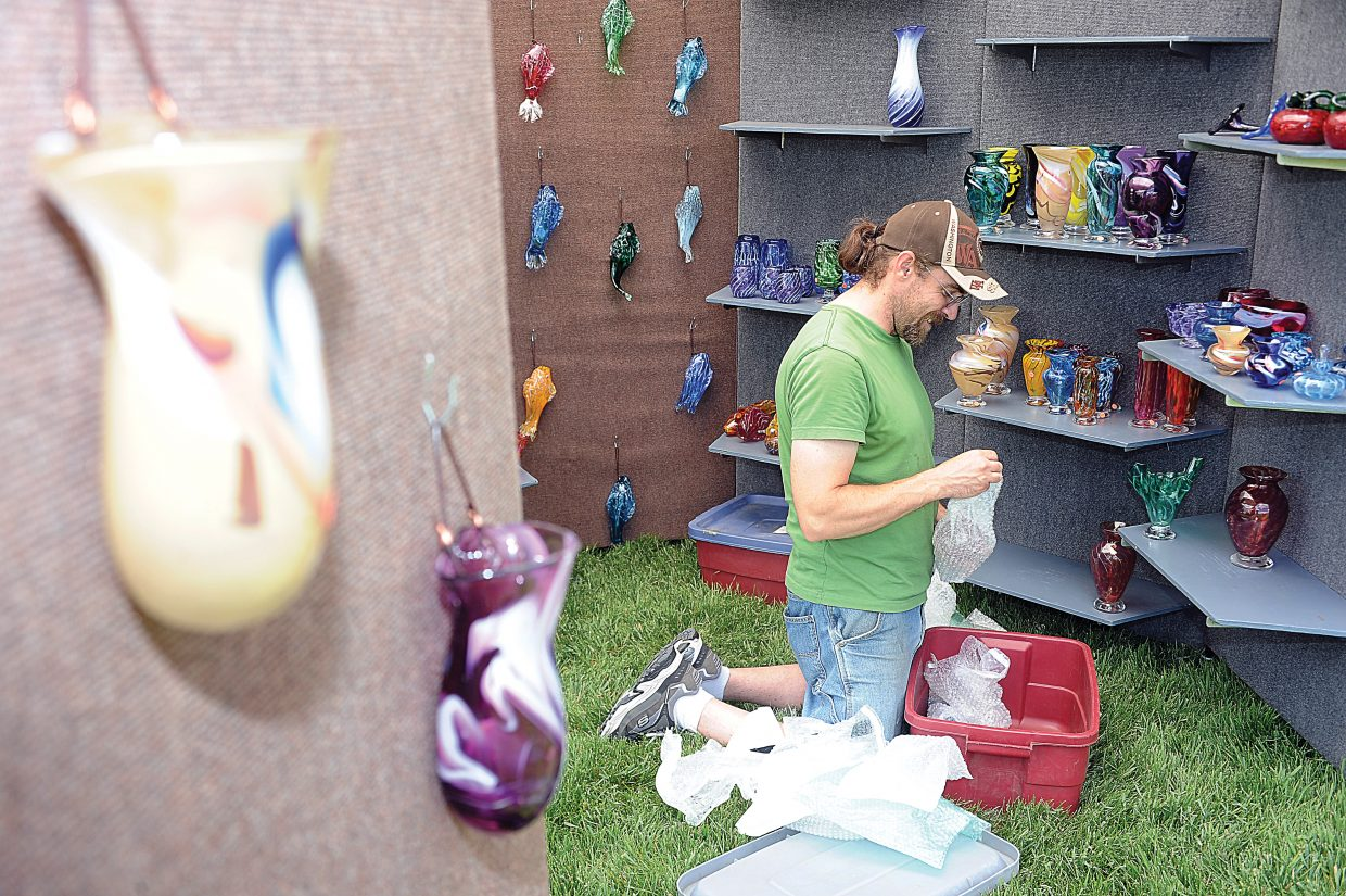 Greg Bowen sets up the Firewind Art Glass tent Friday in preparation for this year's Art in the Park, which begins at 9 a.m. Saturday and runs until 5 p.m. The art festival continues from 9 a.m. to 4 p.m. Sunday.